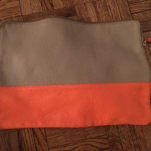 Beige and orange clutch
